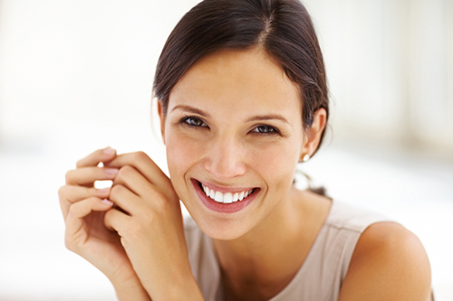 Woman with hands clasped iStock 000015424718Small width of 500 pixels