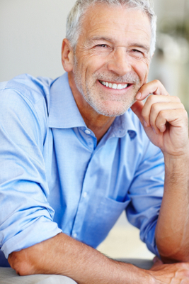 Middle Age Man smiling with hand on chin  middle age  older  mature  senior  smile